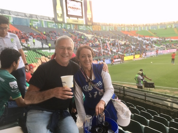 This picture of Michael and the beer vendor at the football match is a little fuzzy. Maybe two coronas per cup has something to do with it.