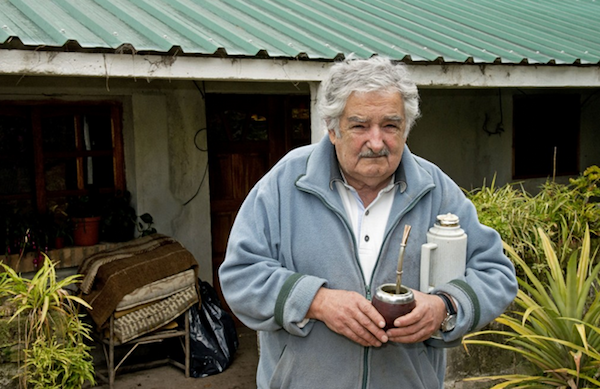 Former President Mujica in front of his simple home (with his mate, of course). He is a folk hero to many.