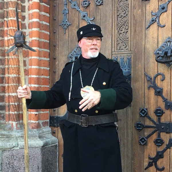 """Our animated """"night watchman"""" guide told the group very entertaining stories in Danish. Then he would turn to Michael and I as the only English speakers and give us a very brief recap. We'd have to rely on his broad gestures and the response from our fellow guests to fill in the gaps."""
