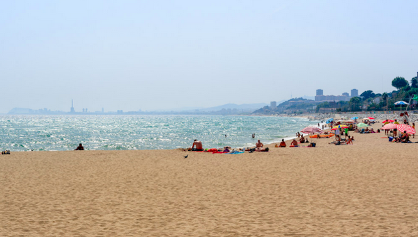 There are perfectly nice beaches just outside Barcelona where the water is warm and the beer is cold.