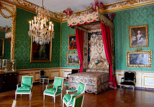 This is Louis the XIV's bedroom at Versailles. He has a similar one at Fontainebleau but this photo shows how copious amounts of different silks were used on the walls, the bedding, and the chairs.
