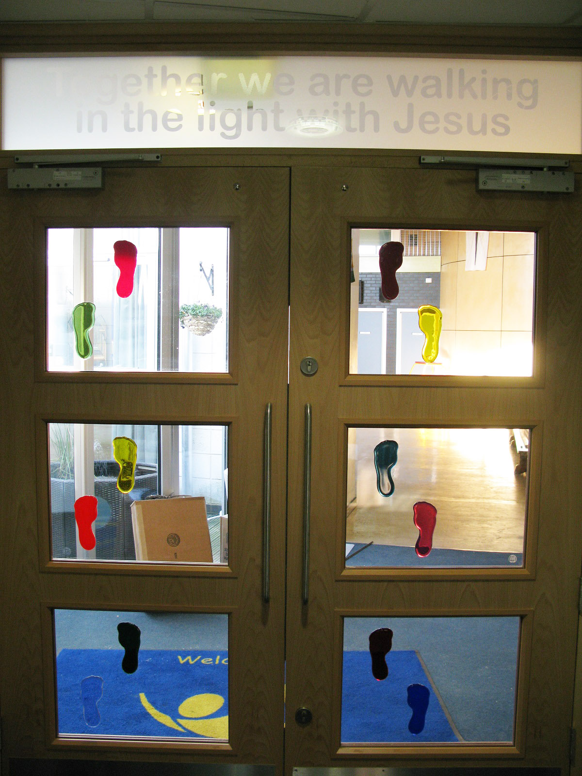 School doors with fused glass feet and sanblasted toplight.jpg