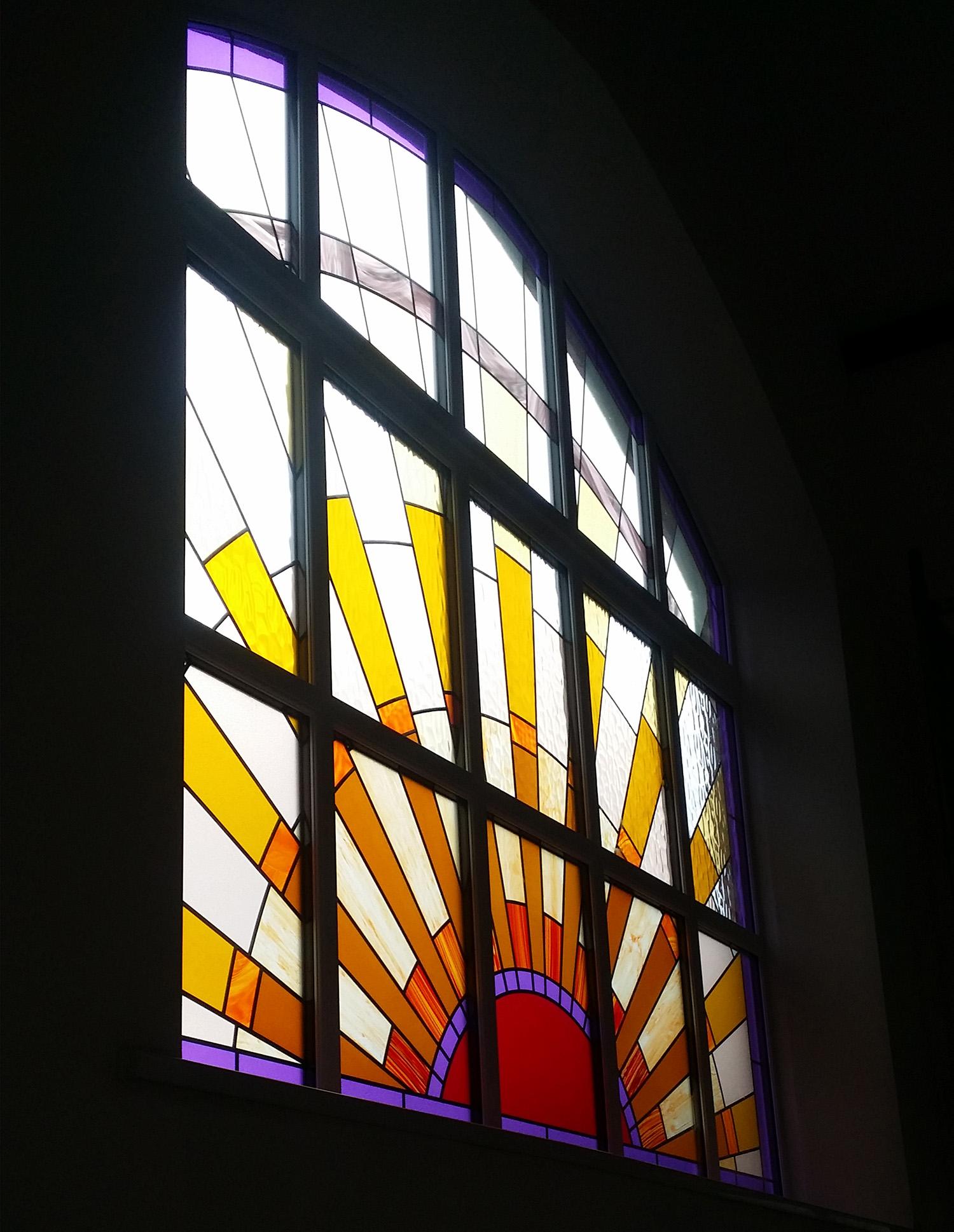 Large Sunburst Window in Chapel Conversion