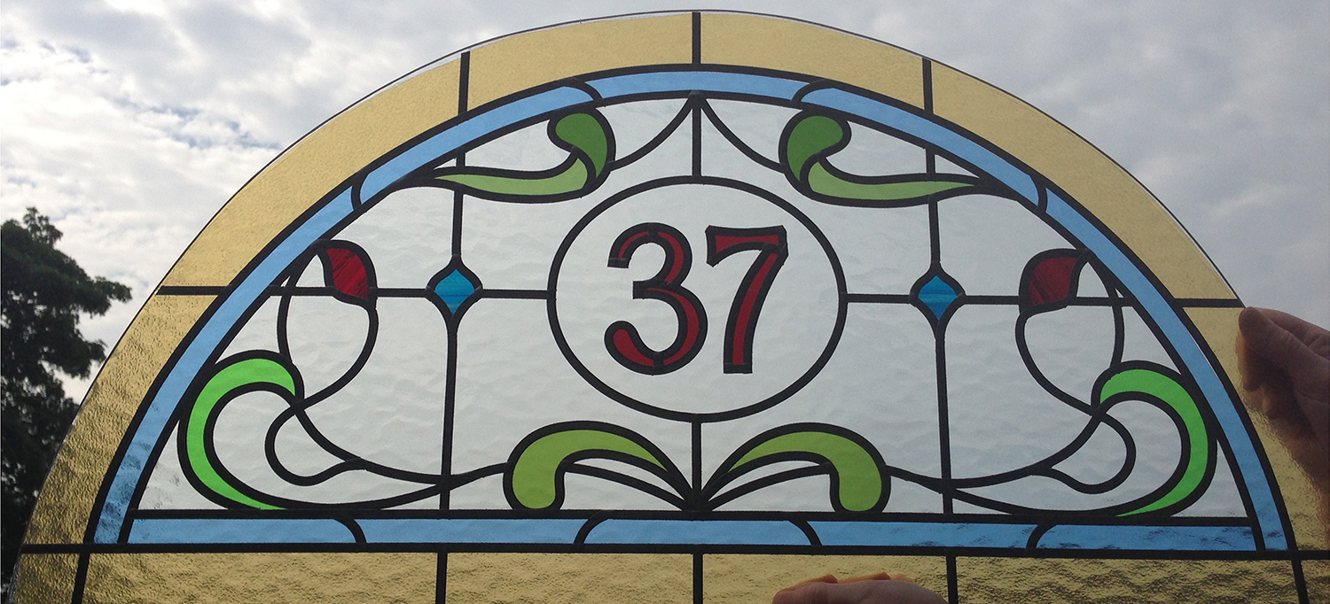 Arched Numbered Fanlight Design