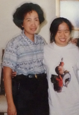 A blurry picture of Dr Bookworm wearing her Tin Toy shirt with her mom--even though I don't look like it, I think I'm 18 or 19 in this pic. (posted with permission of my mom) Thumbnail photo is a still shot of  Tin Toy  by Pixar Animation Studios, 1988