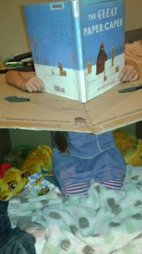 Little Lion reading inside the Eye of the Princess, a spaceship.  The top flap holds the steering wheel.