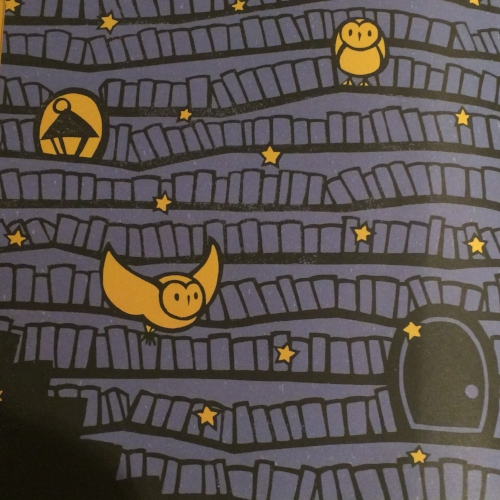 The owl assistants sitting on bookstacks in  The Midnight Library  by Kazuno Kohara.