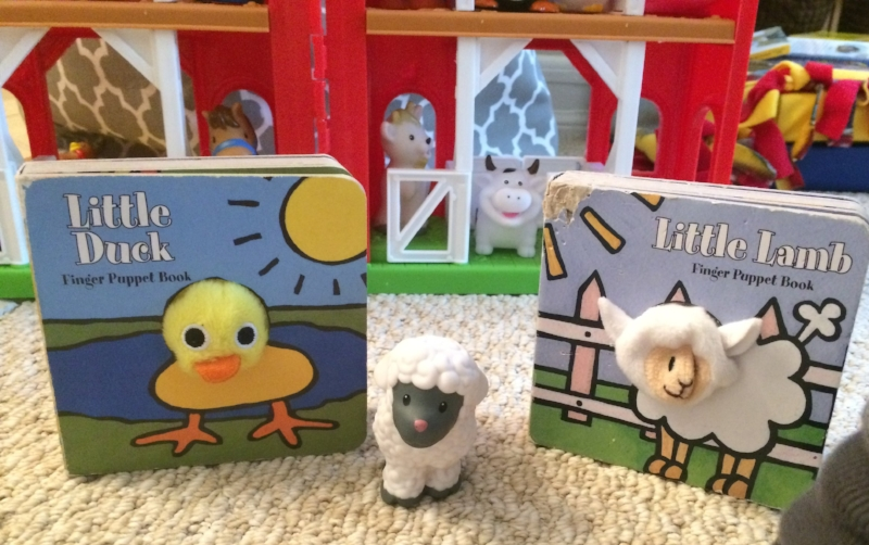 Little Duck  and  Little Lamb  in front of a Little People farm. See how well-loved the books are? Pictures posted with permission. Please note the wonderful artwork in the background of the thumbprint picture. My sister's house is like a wonderful little preschool for two.