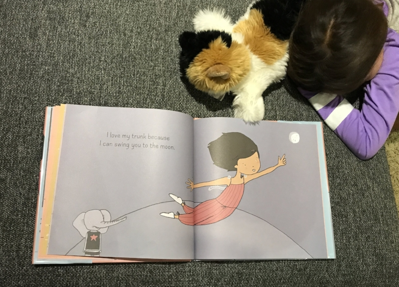 I love all of the animal's unpredictable answers in  What Do You Love About You?  by Karen Lechelt. Little Lion is falling asleep here as it was past her bedtime when we read this one last time. Below is a book teaser clip from Karen Lechelt's site.