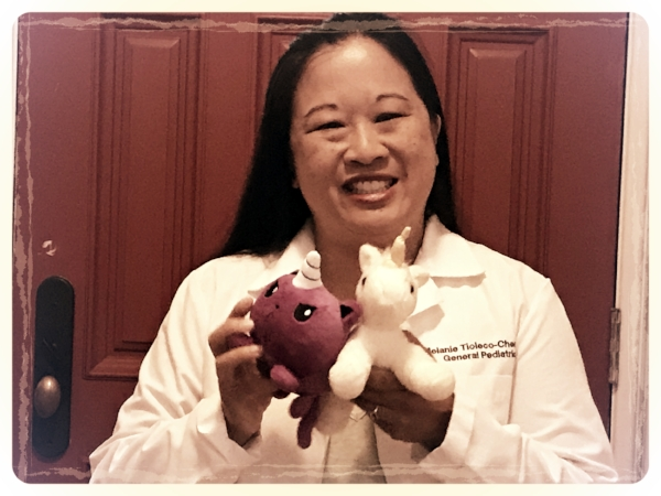 This is me, the unicorn doctor, with some unicorn friends. The purple one is a 'kitten corn' from Tee Turtle. #notanad #it'sjustcute