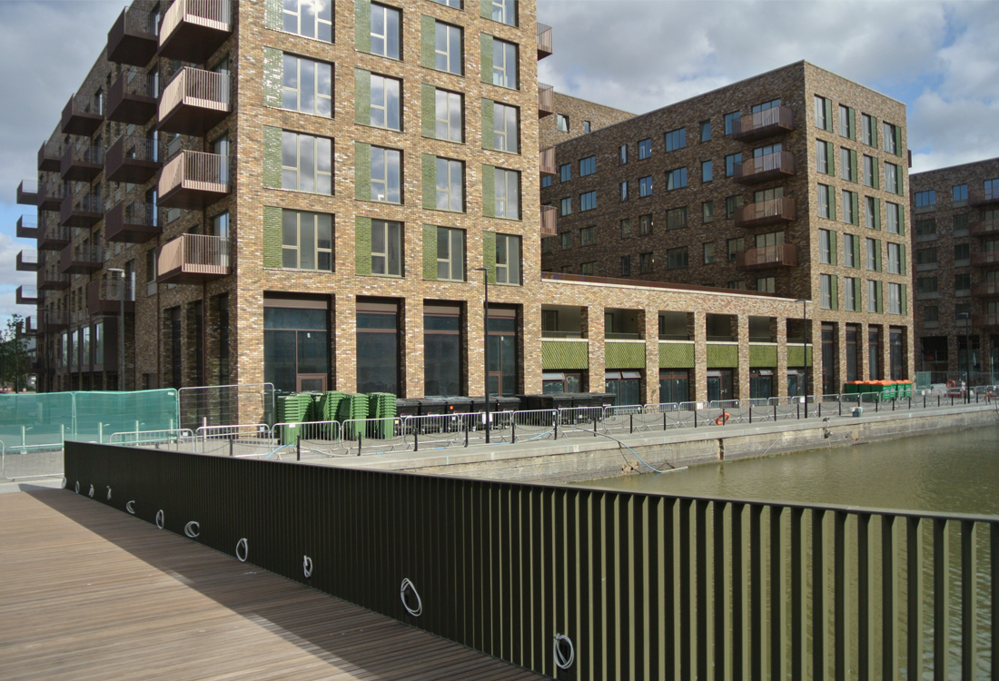 The bridge forms an extension to the public realm, by forming a continuous loop of the commercial dockside, with the colour and materiality relating to the dockside buildings.