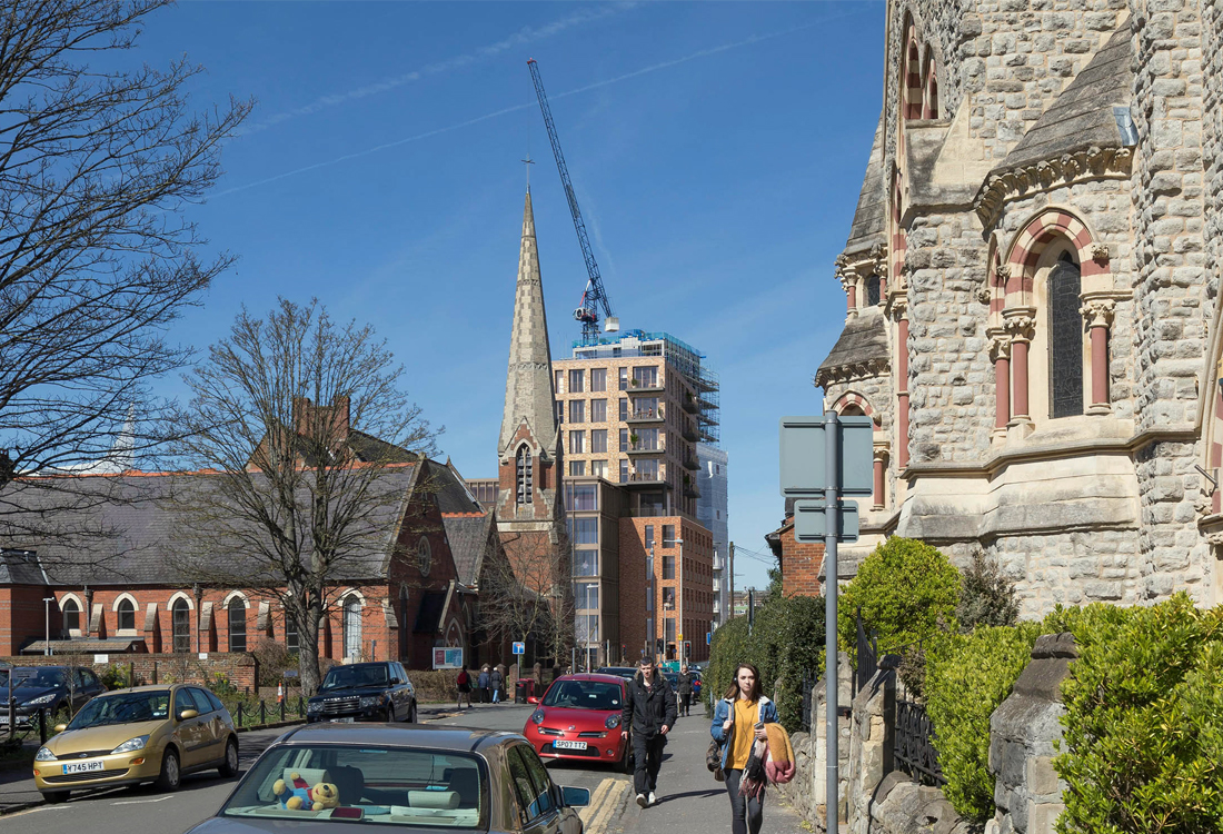 The stepped buildings create a calm backdrop from the Conservation Area adjacent to the site. the brick tones borrow from the grey-and-red tones of the period properties and church.
