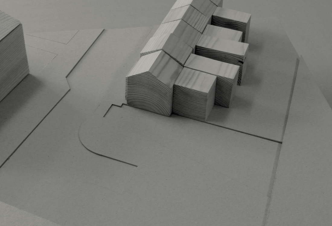 Study model showing the existing constrained end of terrace site bounded by a neighbouring building, the road, rail tracks and a carpark.