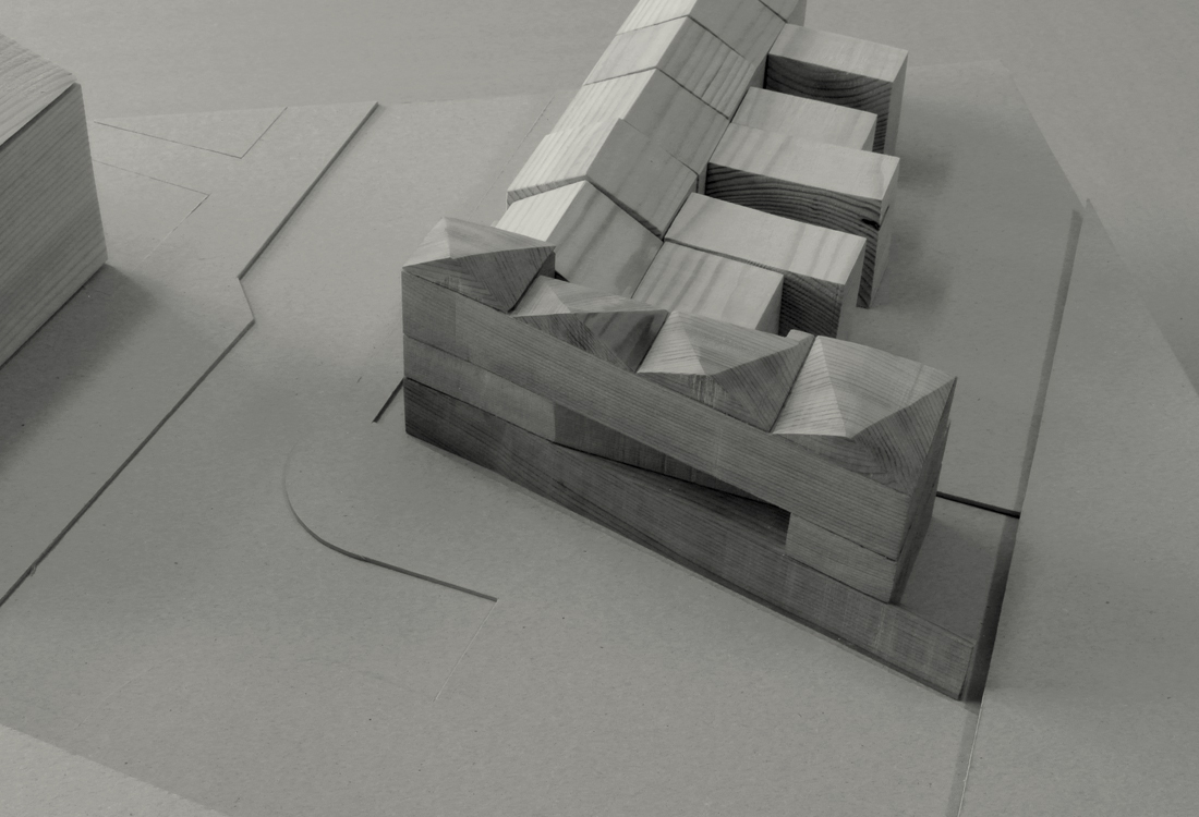 Study model showing the third floor and expressive roof-line. The building steps back from the adjacent property to create a private terrace. The sawtooth roofline to the north breaks up the length of the building with the overall height matching a building opposite to create a coherent relationship at this end of Norman Road.