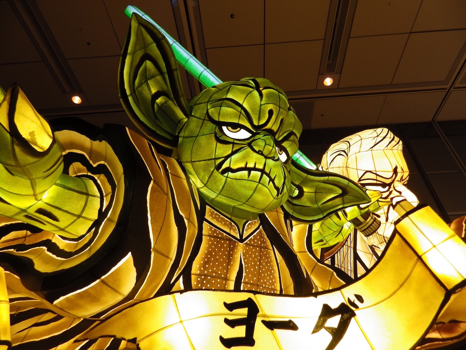 "A visiting parade float from the city of Aomori lights up a darkened room, at the ""World of Star Wars ""  exhibition, which ran for twelve days in Tokyo, in December 2015."