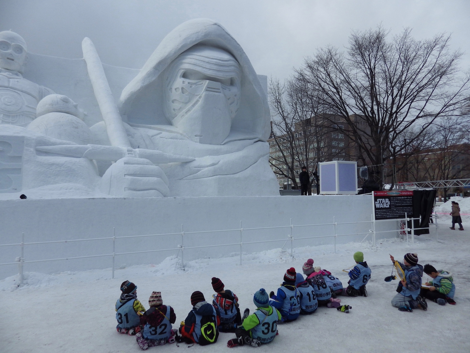 Kylo Ren addresses a group of younglings (most likely before slaughtering them with his crossguard lightsaber) during the 2017 Sapporo Snow Festival in Japan.