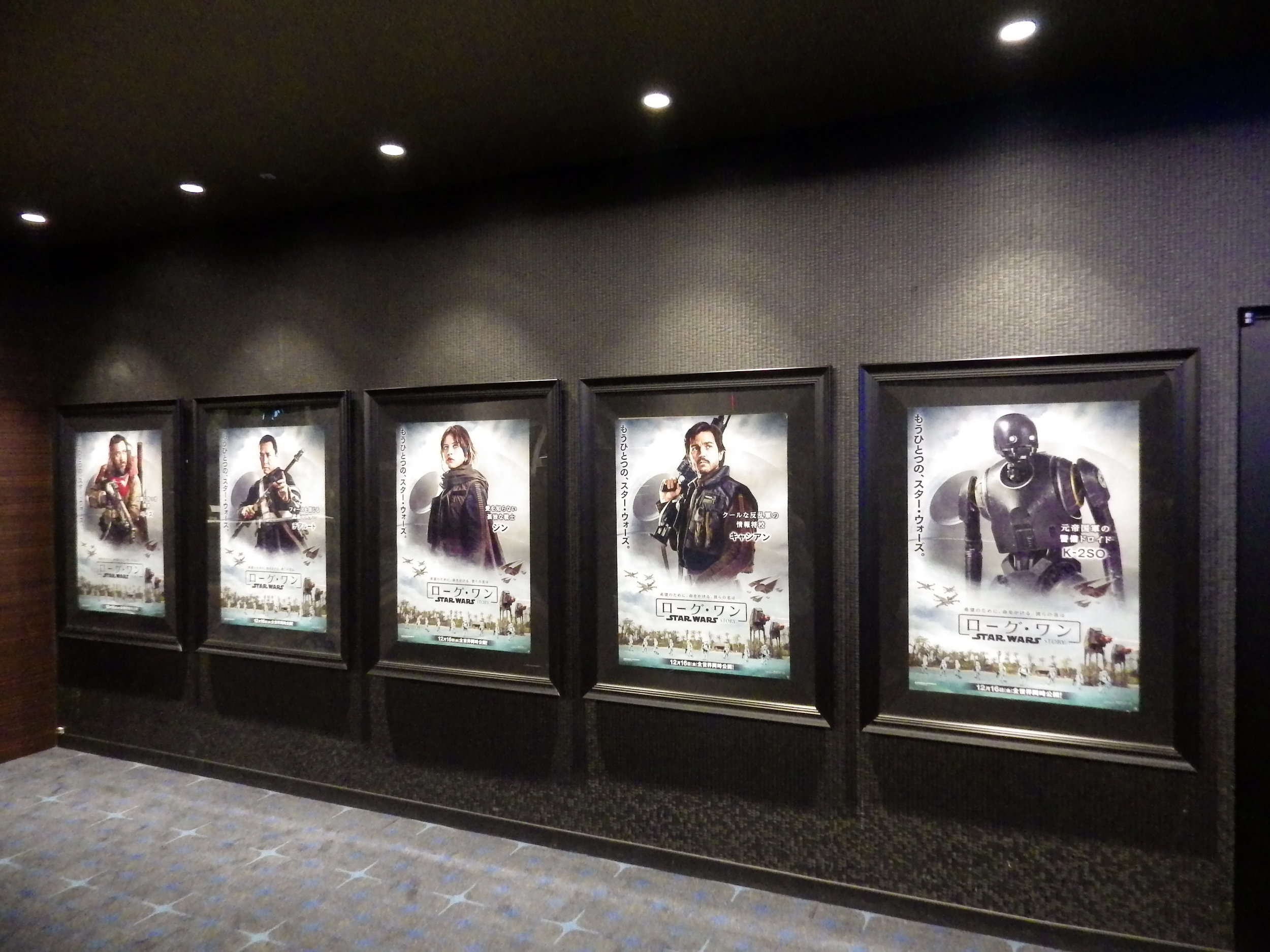 Rogue One  character posters on the wall of the theater lobby.