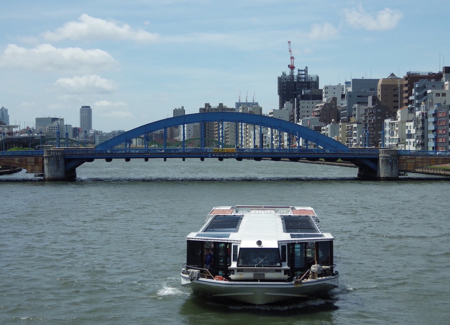 A water bus on the Sumida River, as seen from the Azuma Bridge, near Tokyo's Asakusa district.