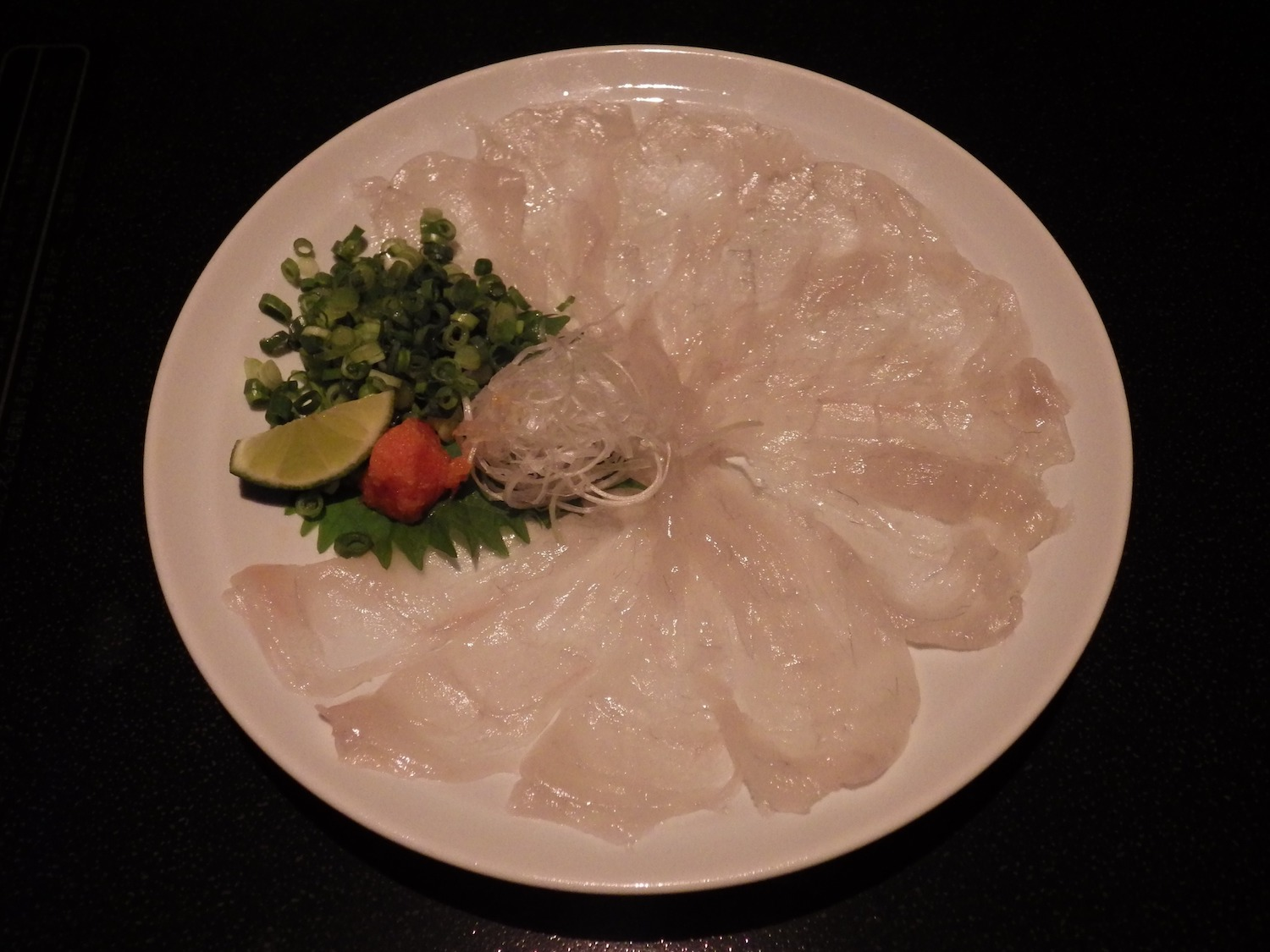 A plate of thinly sliced  fugu , otherwise known as pufferfish or blowfish, at a restaurant in Tokyo.