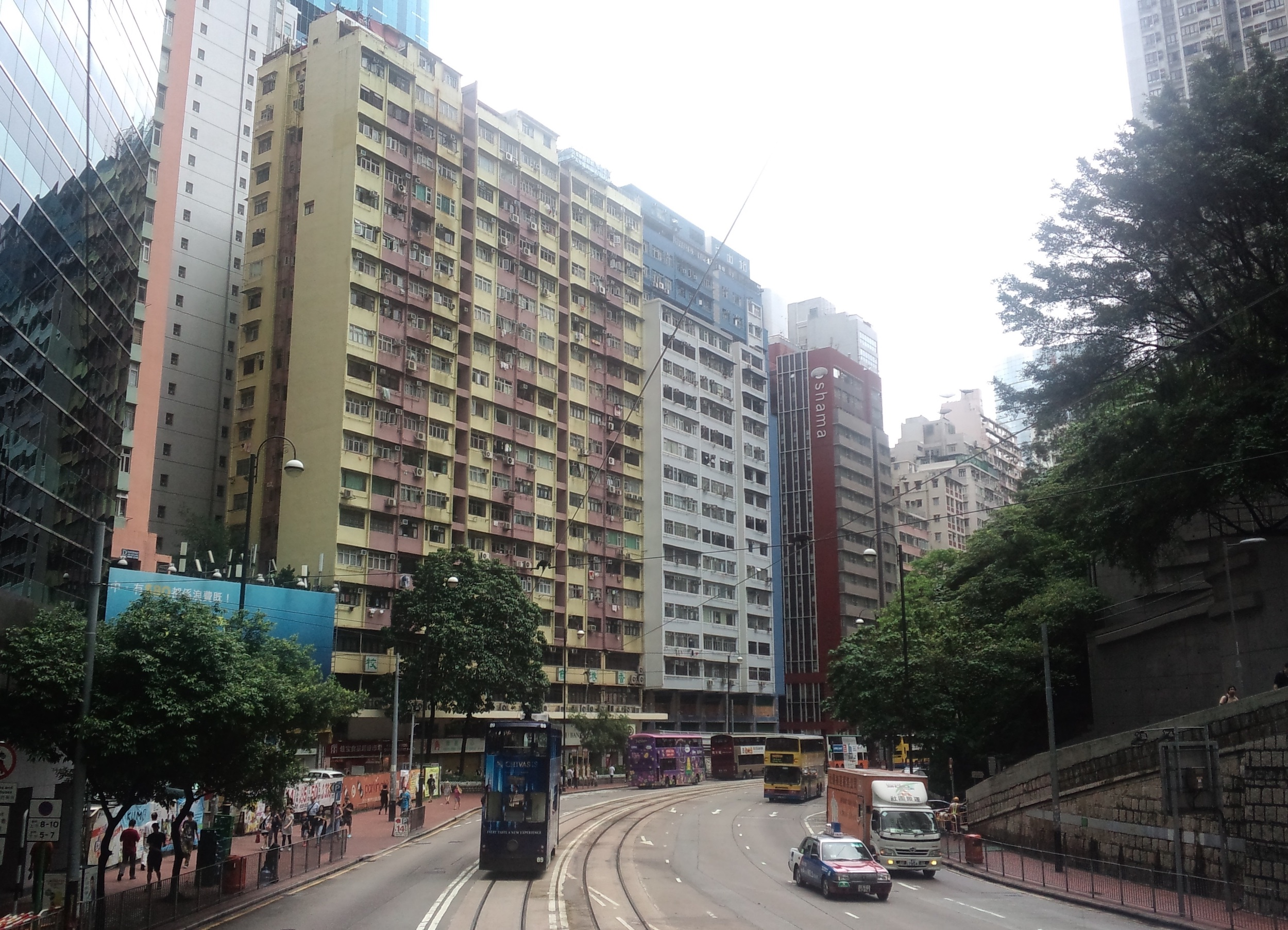 High-rise apartment buildings in Hong Kong, as seen from the upper deck of a tram.