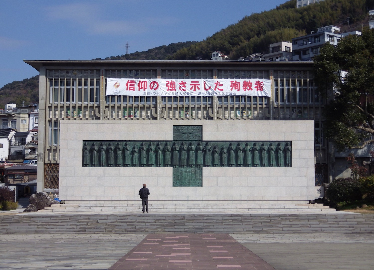 Behind the monument, there is a museum that houses artifacts.