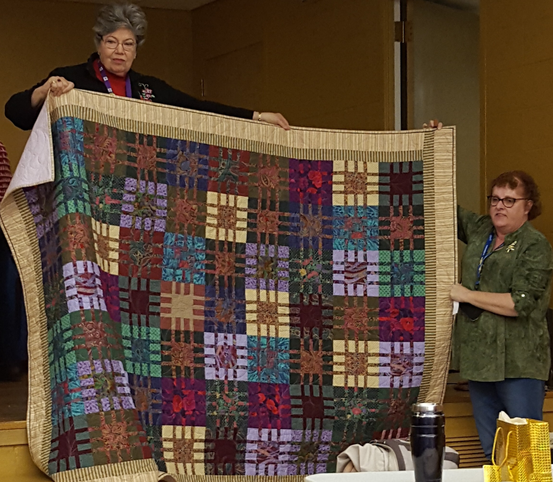 And the guild only raffle quilt went to: Lisa White !!! -
