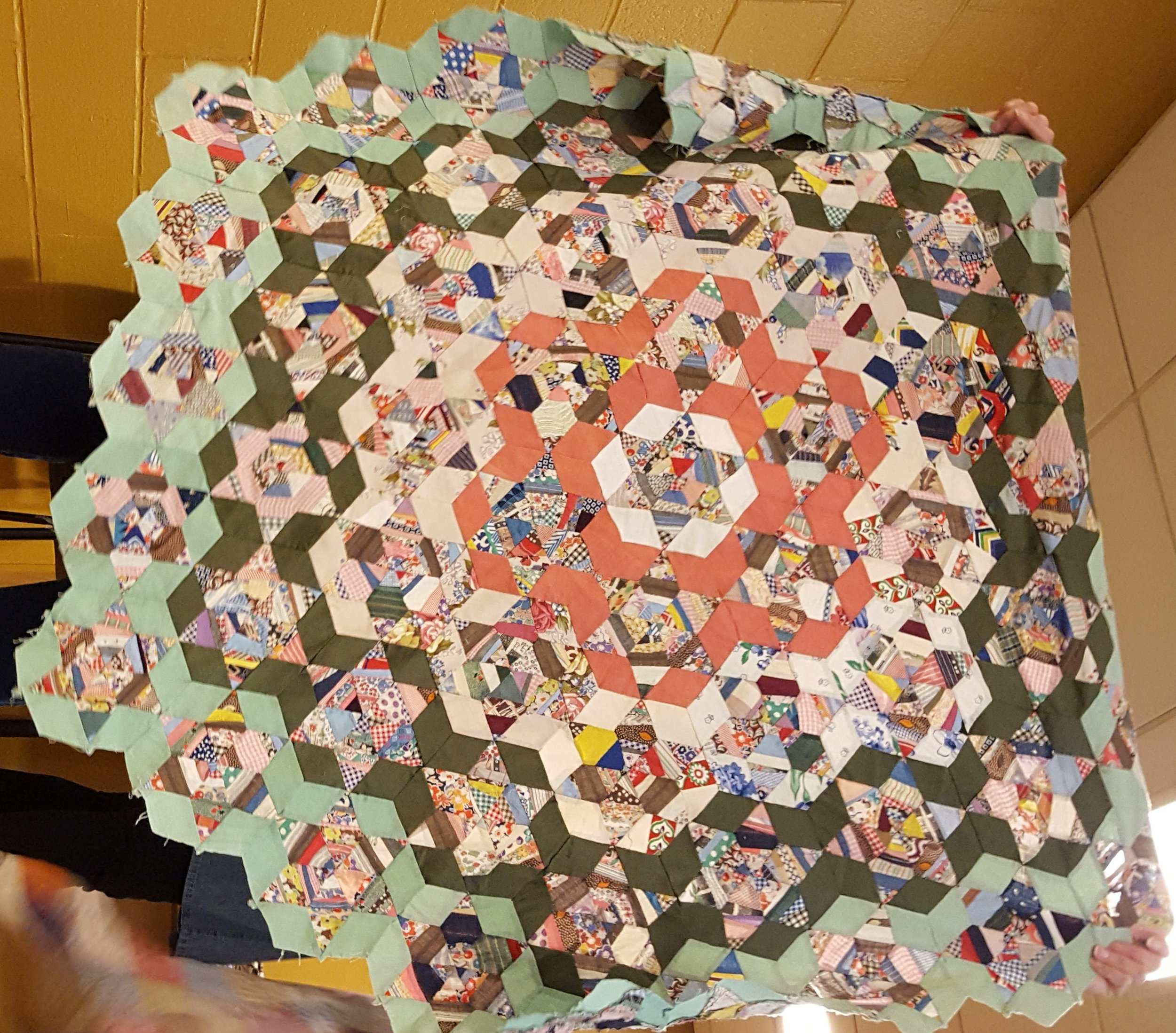 medallion triangle strings made into hexies.jpg