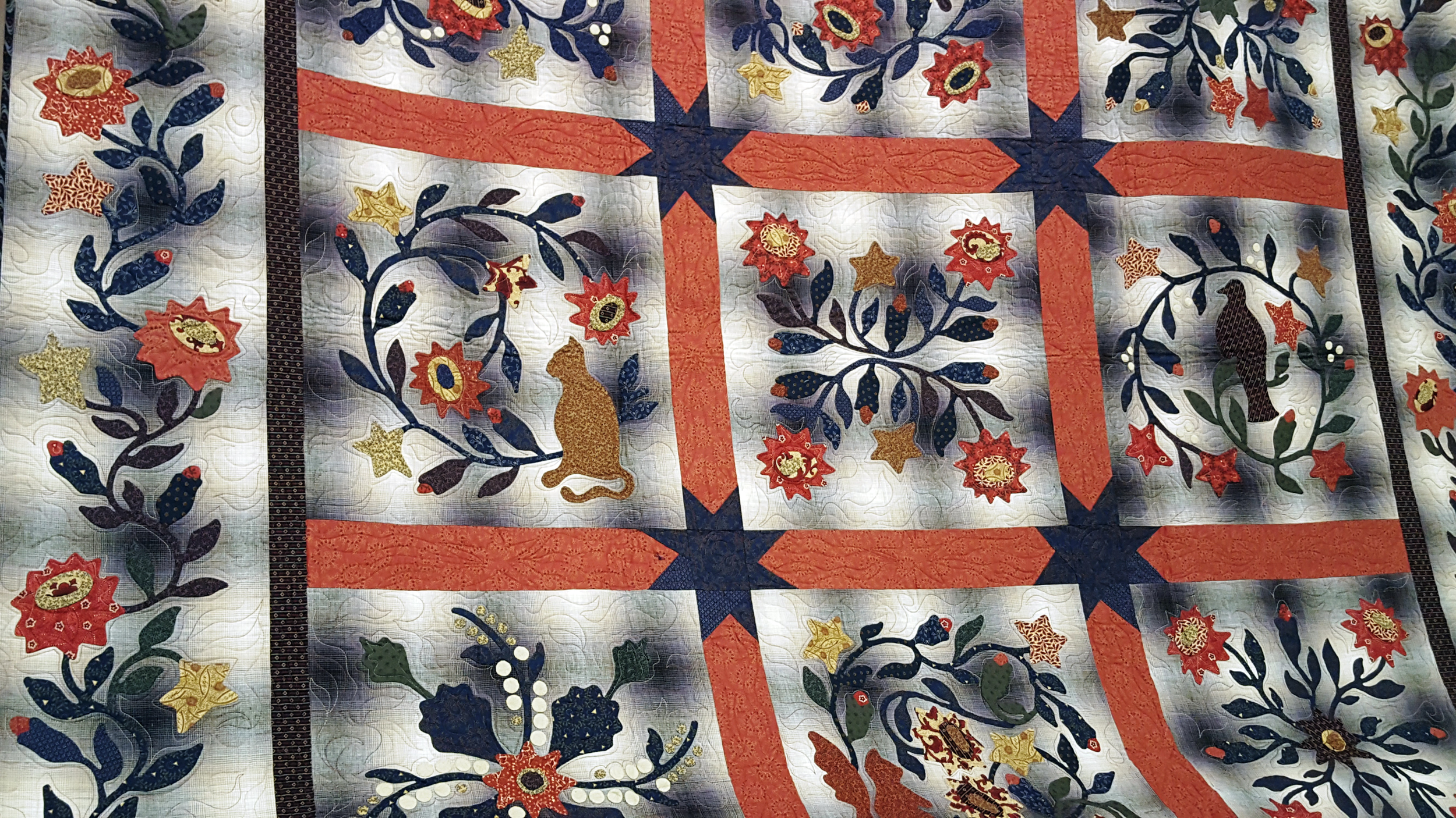 kathy 10 quilt wide closeup banner.jpg