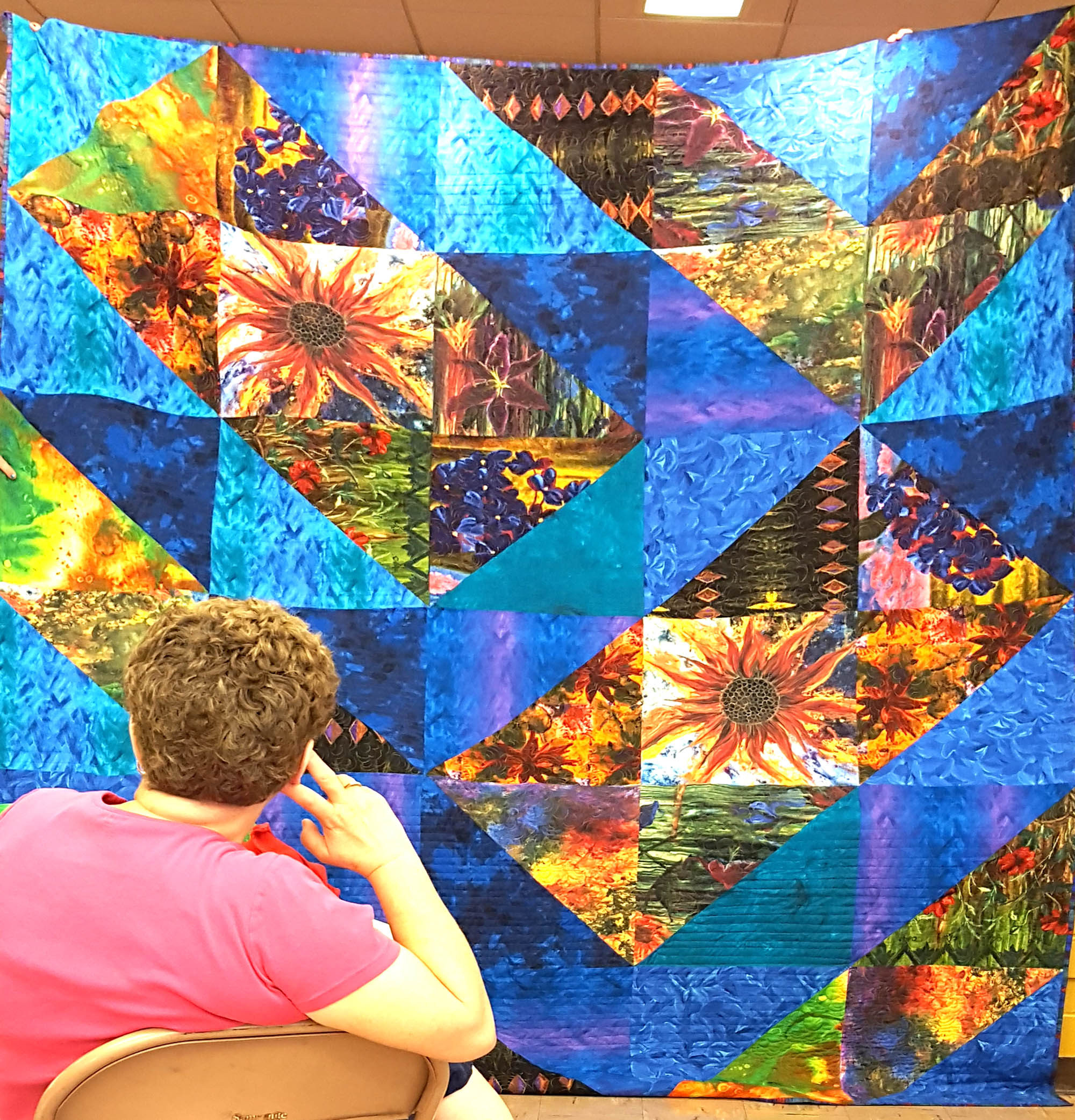Large quilt demonstrating using full flowers and other fabrics.jpg