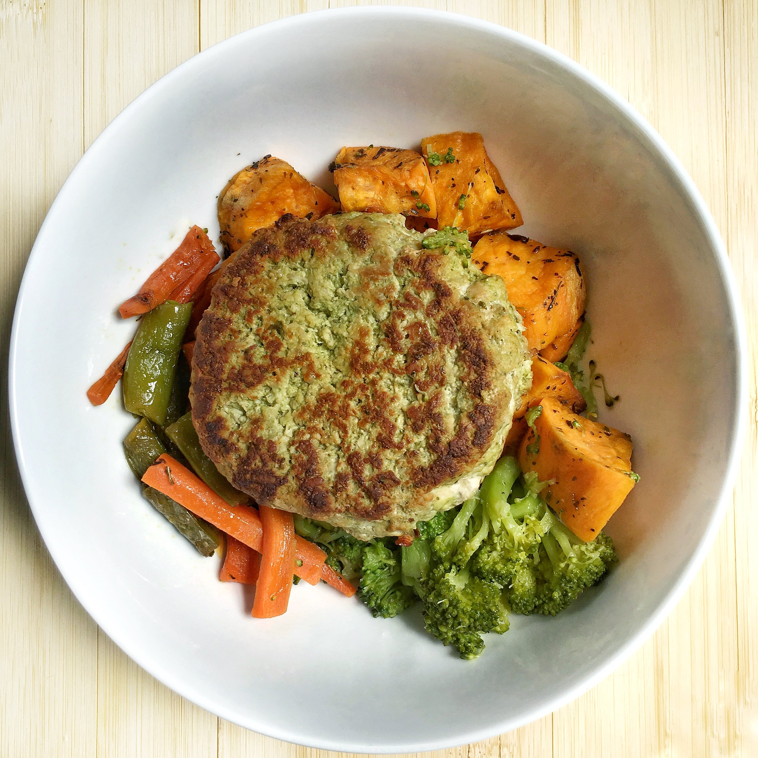 [Spinach Basil Pesto Chicken Burgers, oven roasted sweet potato, steamed broccoli, and teriyaki sautéed carrots and snap peas]