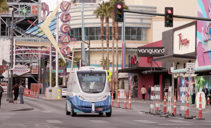 The driverless electric shuttle carries passengers in a test program in downtown Las Vegas.