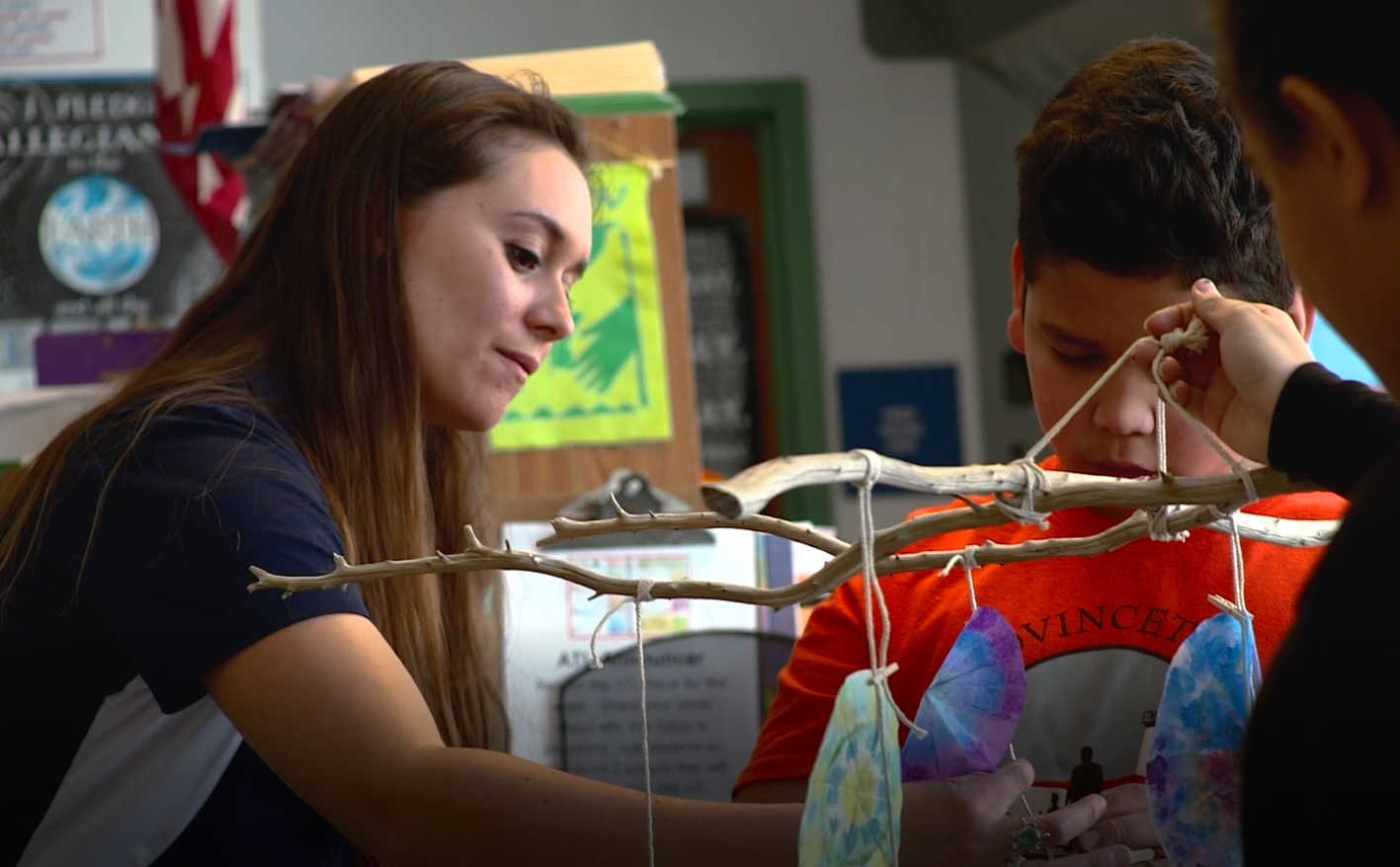 """OPAK Co-Founder and President, Melanie Colby, helping a group of students construct their """"Sun-catcher Diatoms."""""""