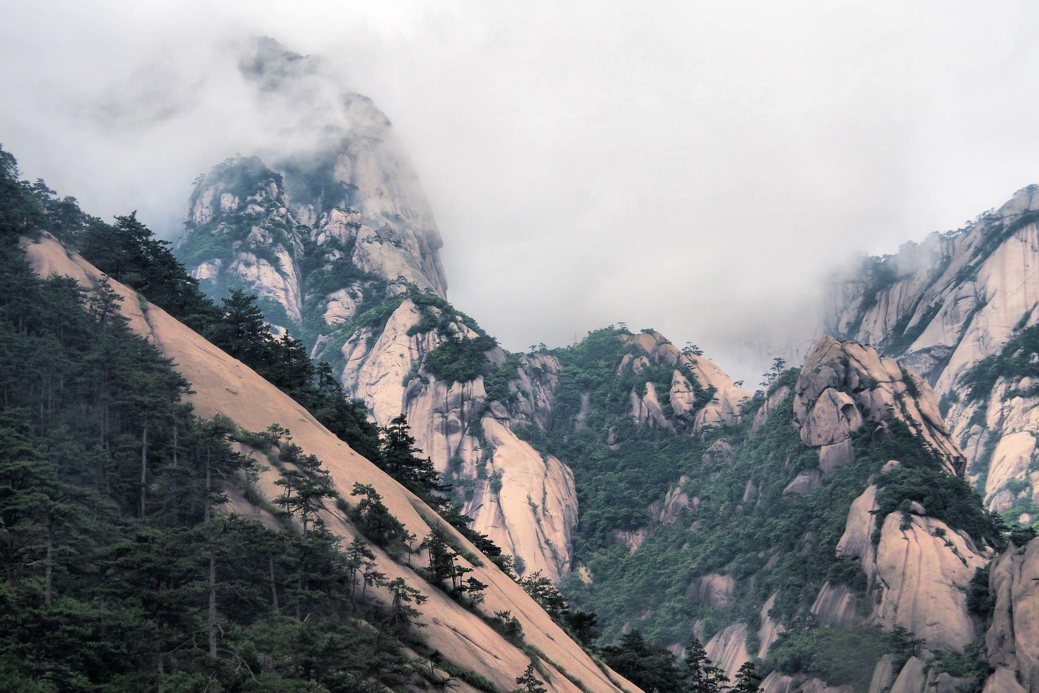 The top of Huangshan offers otherworldly views. Just ignore the masses of people, it's still worth going