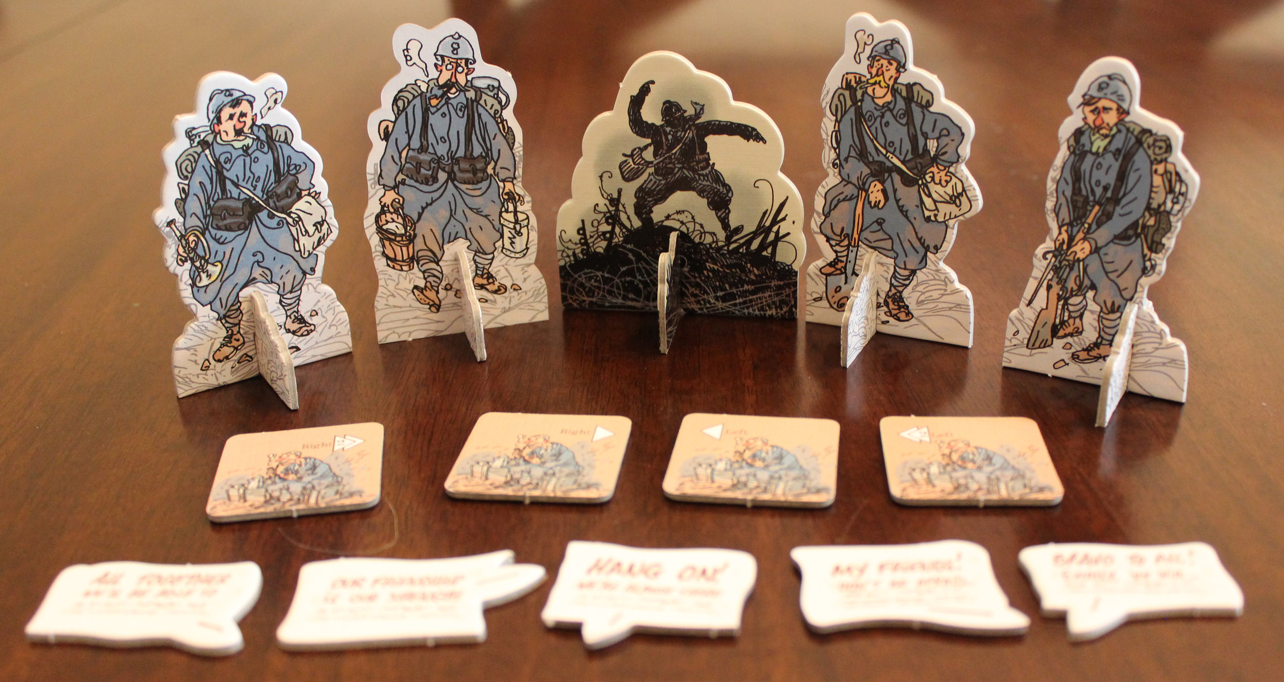"""Some of the character standees, the """"leader"""" standee, sample support tokens and speech tokens."""