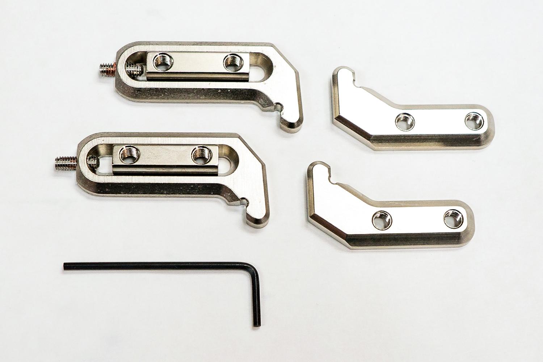 FIGURE 1. Hercules Hooks parts. Fixed Hooks on right, Adjustable Hooks on left, hex key for adjusting set screws below.