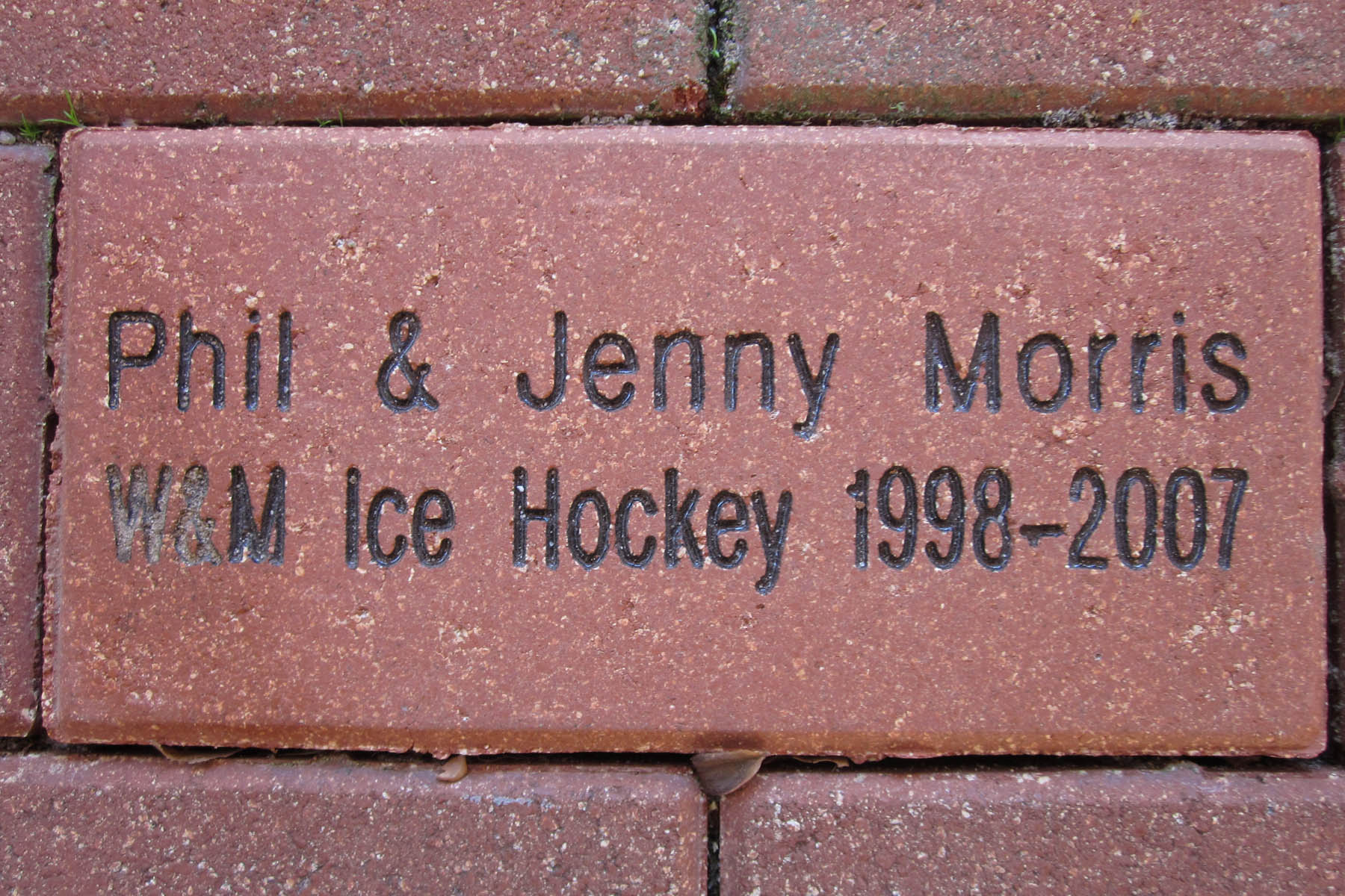 The Tribe Hockey booster club honored the commitment Phil and Jenny Morris made to the team by placing a brick in the Elizabeth J. and Thomas C. Clarke '22 Plaza of the Alumni House.