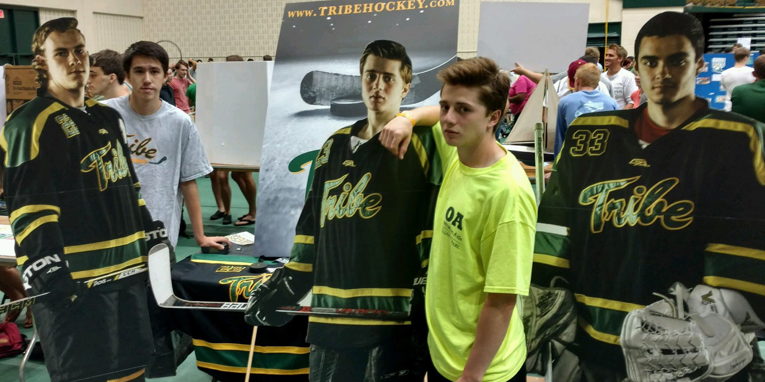 Ben Constatine '19 (left) and Conor Rooney '18 (middle) joined team manager Colleen Heberle '18 as well as players George Andros '19, Captain Julian Kell '18, President Derek Prario '18, Alex Hayes '19, and Jack Jenet '19 at the Tribe Hockey booth.