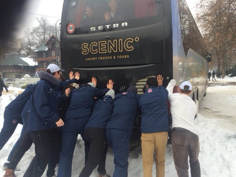 The ACHA national team pushes their bus out of a snow bank in Poland. (Photo courtesy Julian Kell)