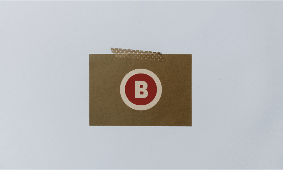 Example of the final printed result. A white ink card on kraft colored recycled paper.