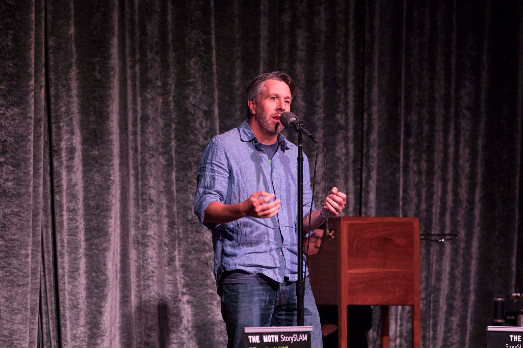 Storyteller Matthew Struski, live at The Moth GrandSLAM, October 22nd, 2018. (Photo credit: Ricky Steel & The Moth)