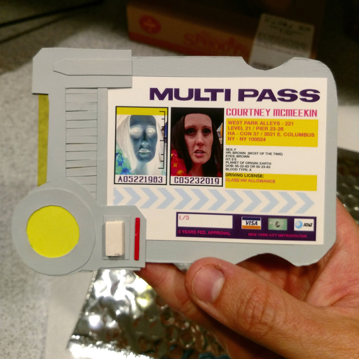 "Papercraft replica of a ""MULTIPASS"" from  The Fifth Element.  Materials used: Crescent wet media board, balsa wood, acrylic paint, card stock & LEE Filter swatch cards."
