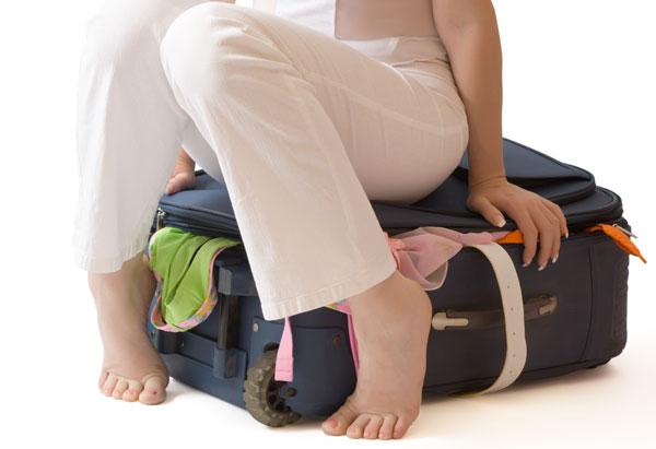 201201-orig-woman-on-suitcase-600x411.jpg