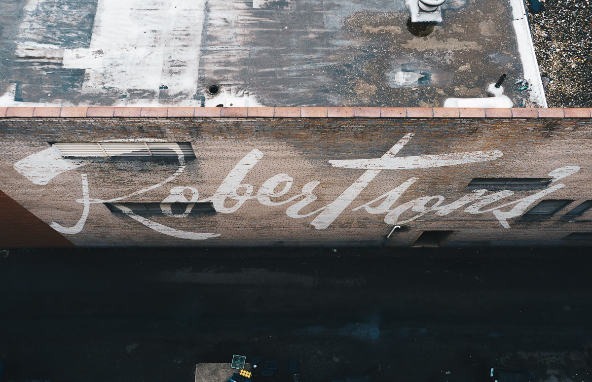 Robertson's No. 1   Founded in 1904 in the 100 block of South Michigan Street, Robertson's was a popular department store in downtown South Bend. This photograph captures a current-day overhead view of a vintage promotional mural.