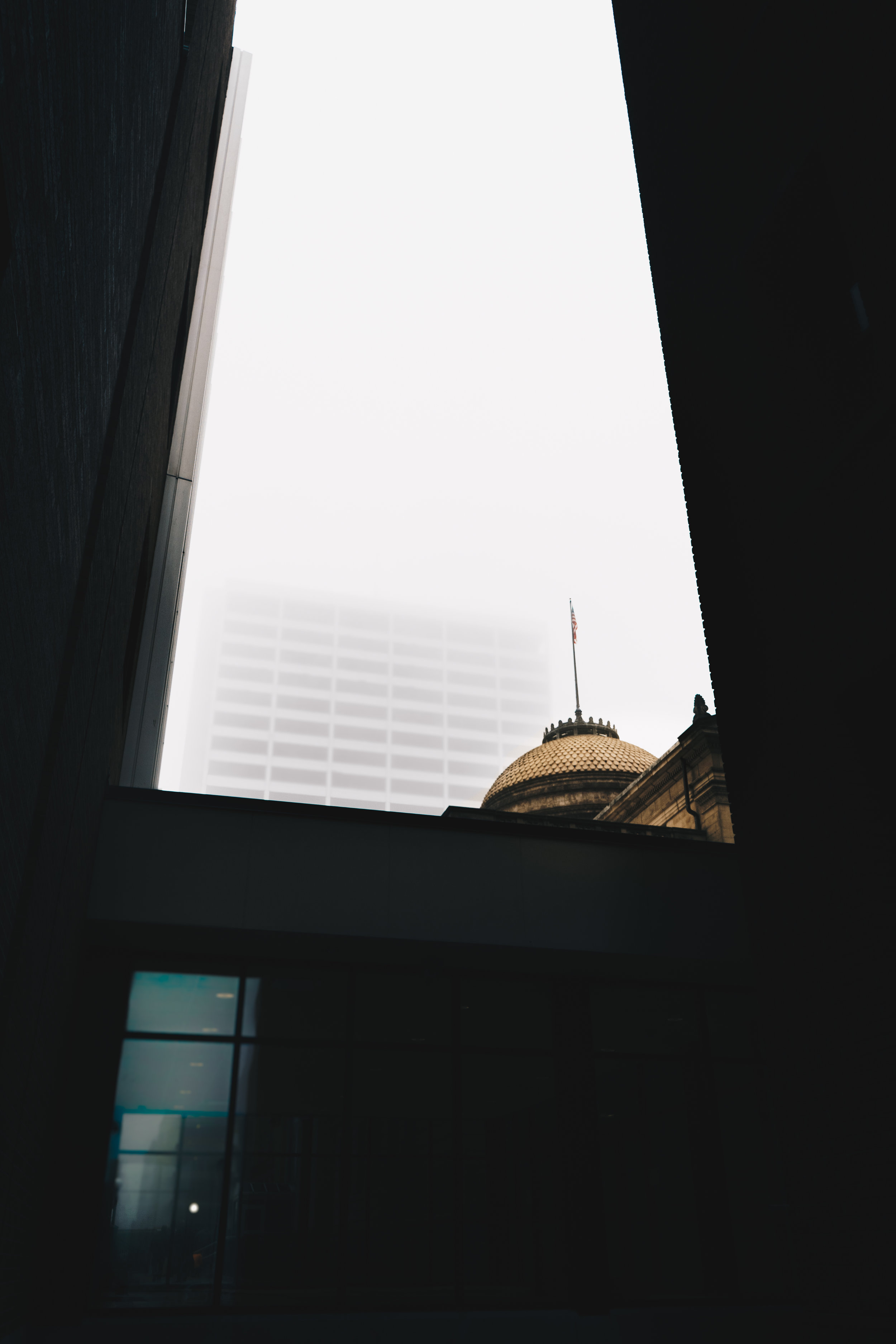 Liberty Tower No. 2   A winter 2017 photograph of downtown South Bend's Liberty Tower seen through a gap between the County-City Building and First Bank Building.