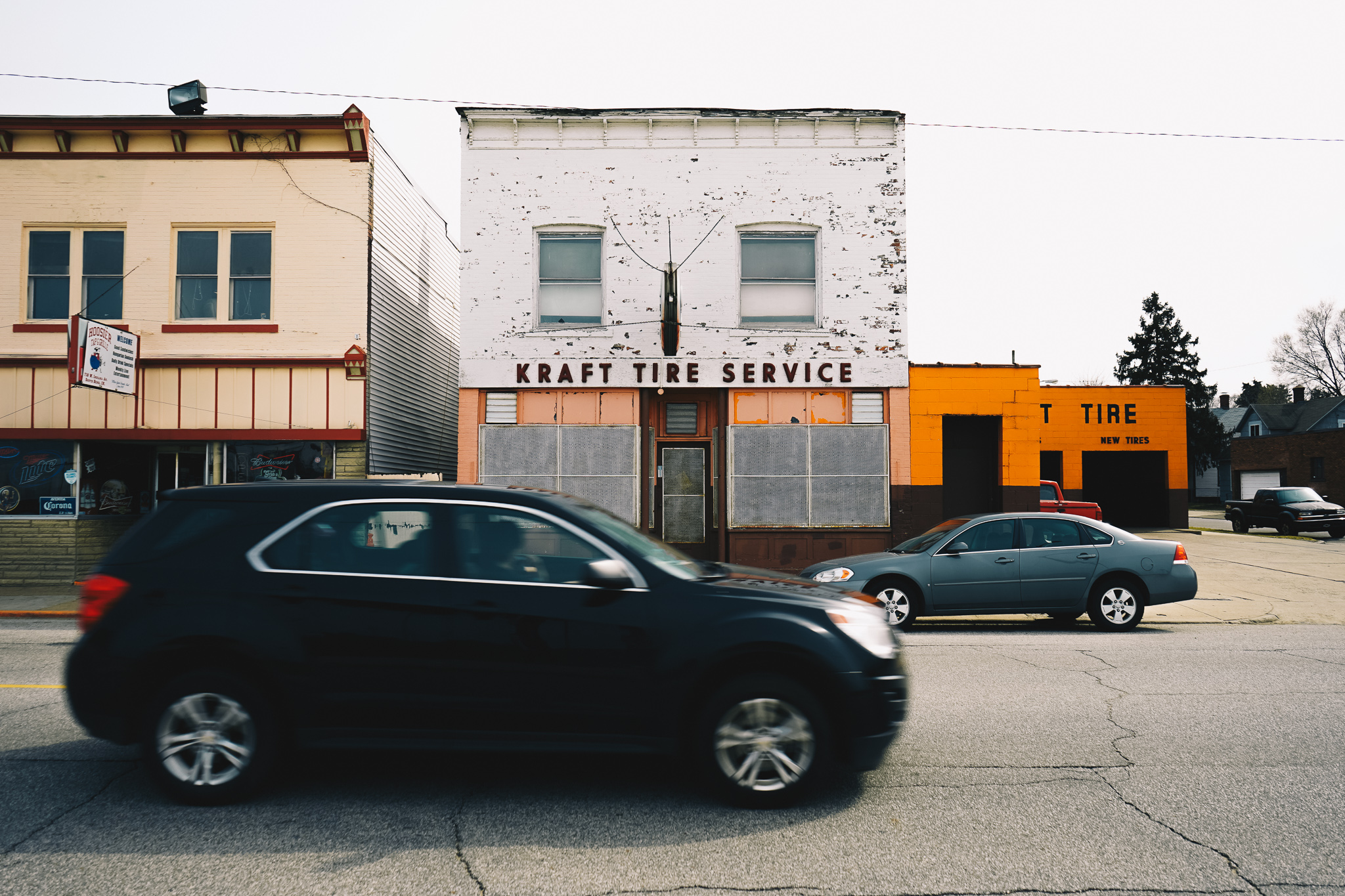 Indiana Avenue No. 1   A view of Kraft Tire Service, one of a string of storefronts along Indiana Avenue between the Rum Village neighborhood and the sprawling land formerly home to Studebaker and Oliver Plow. This photograph was featured in our April 2017 story  Afternoon Stroll on Indiana Avenue .