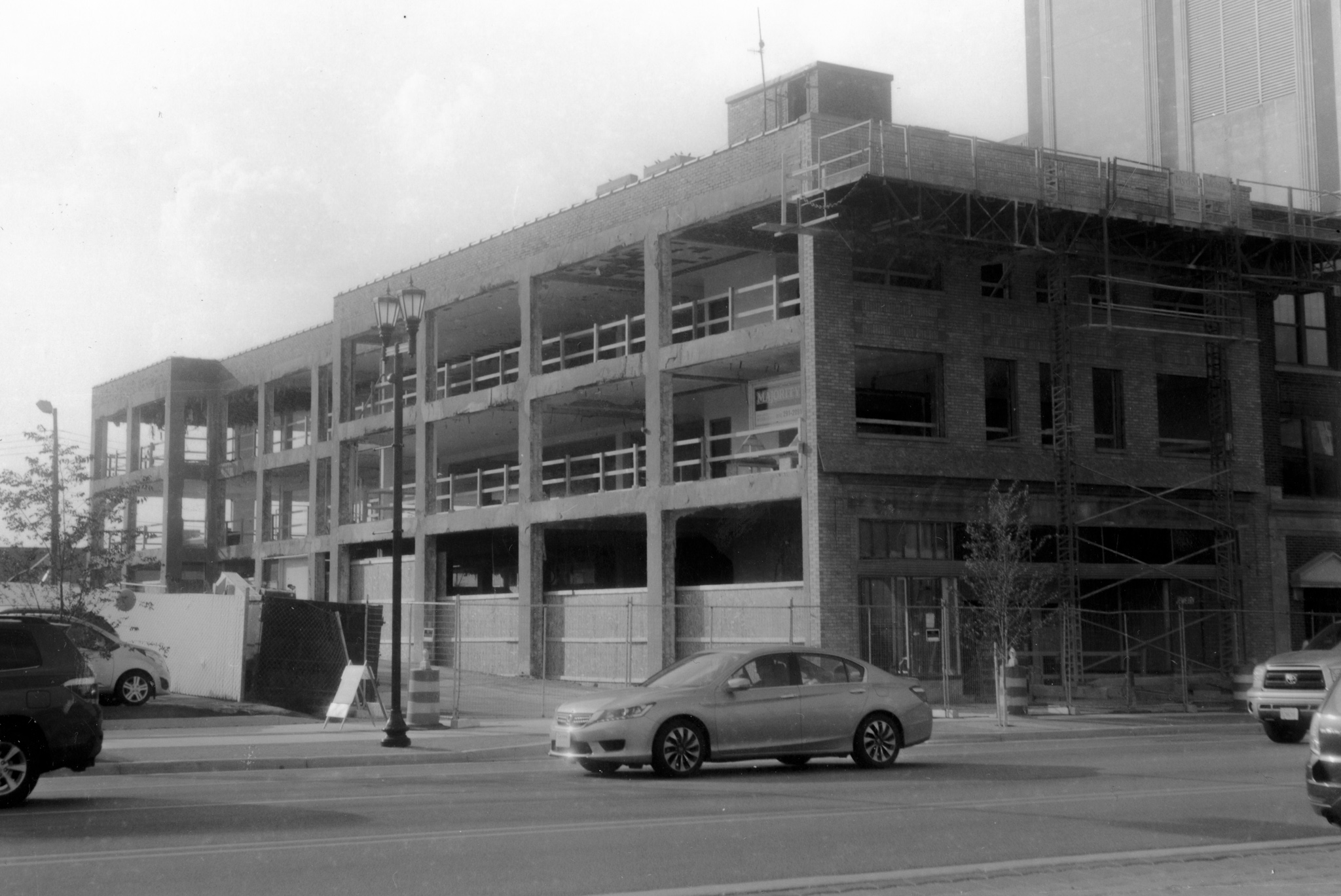 A mid-construction photograph of The Hibberd from across Main Street.