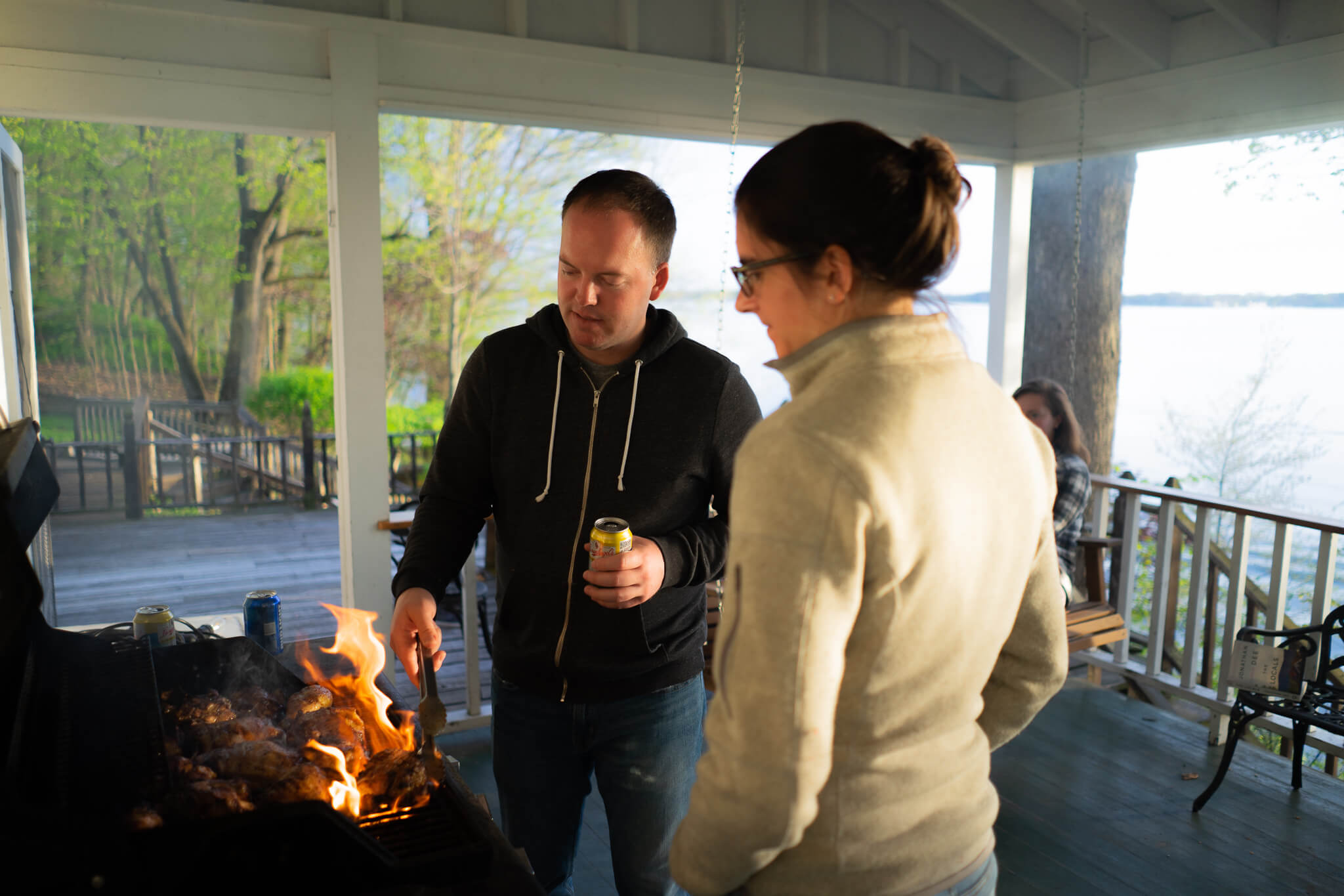 Kevin Lawler  and  Maria Gibbs  grilling (and burning) chicken on the original front porch.