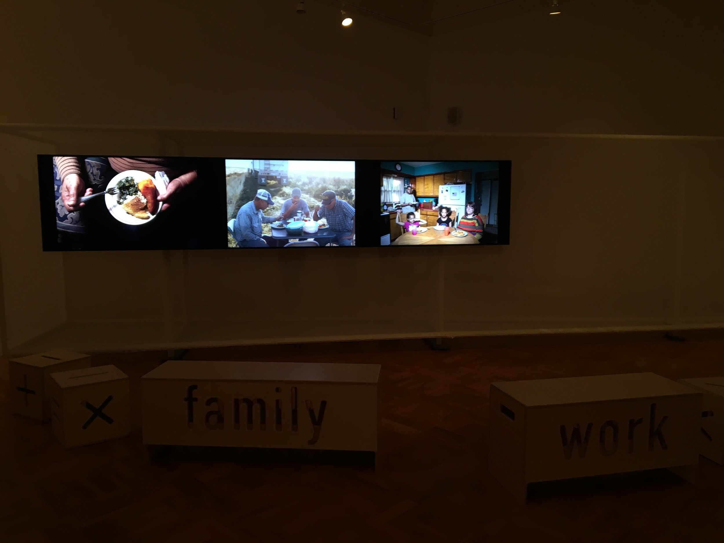Install image, my photograph (Wednesday: Siena, Brian, Alivia and Leah. 2013 from Weeknight Dinners) on right monitor