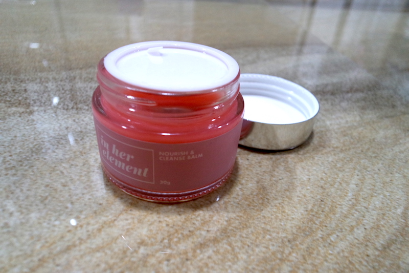 The packaging features a heavy glass jar, sturdy acrylic cap and inner cap - useful for when the balm gets all melty such as in this heat.