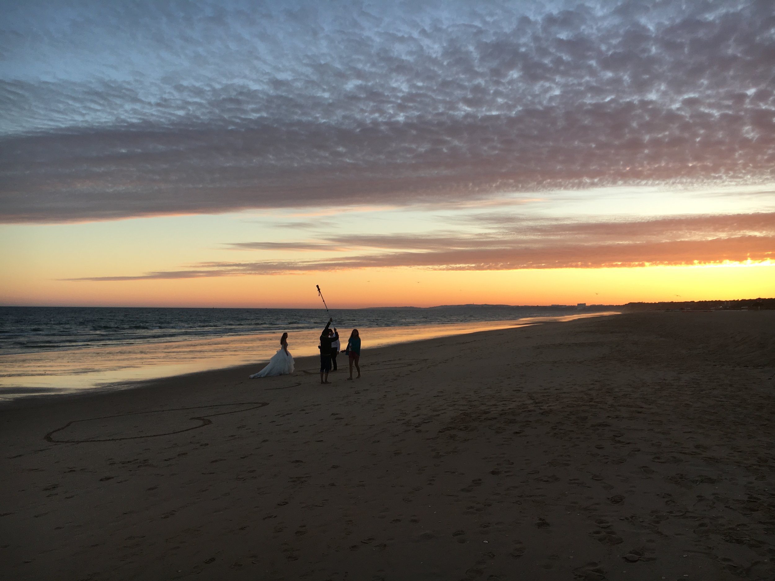 Couple getting married on the beach, Faro, Portugal